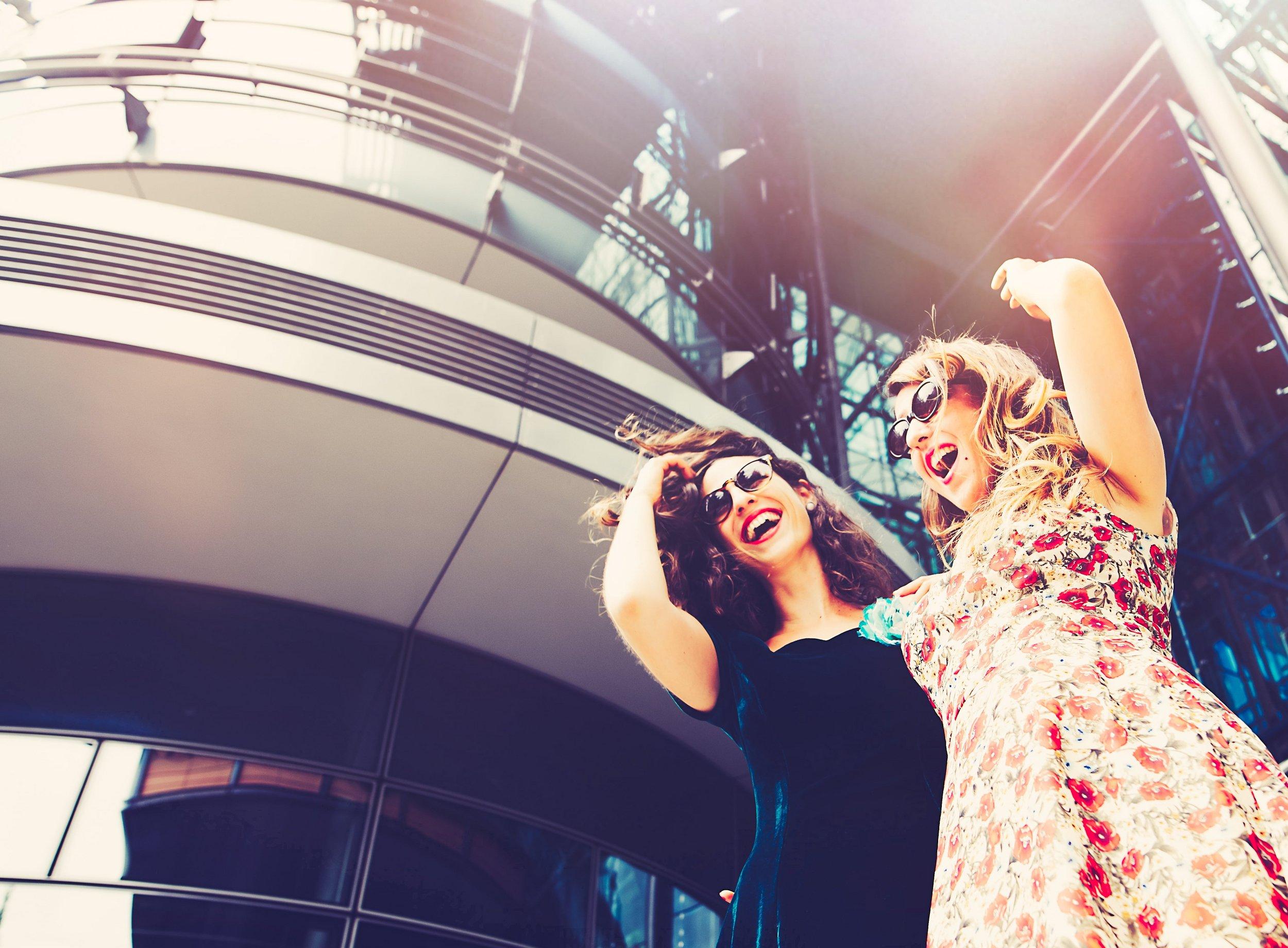 Women having fun in shopping center