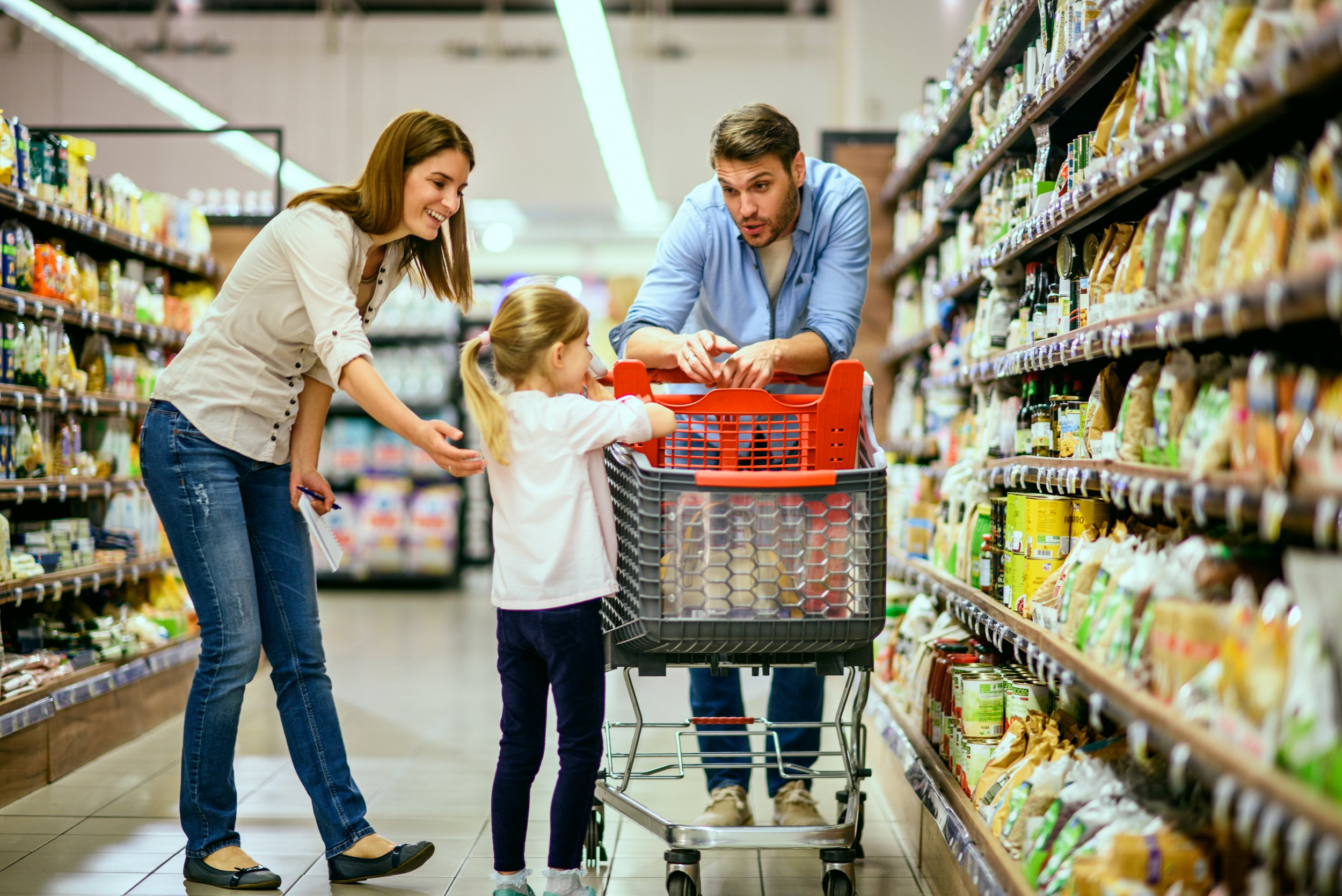 Family shopping in grocery store
